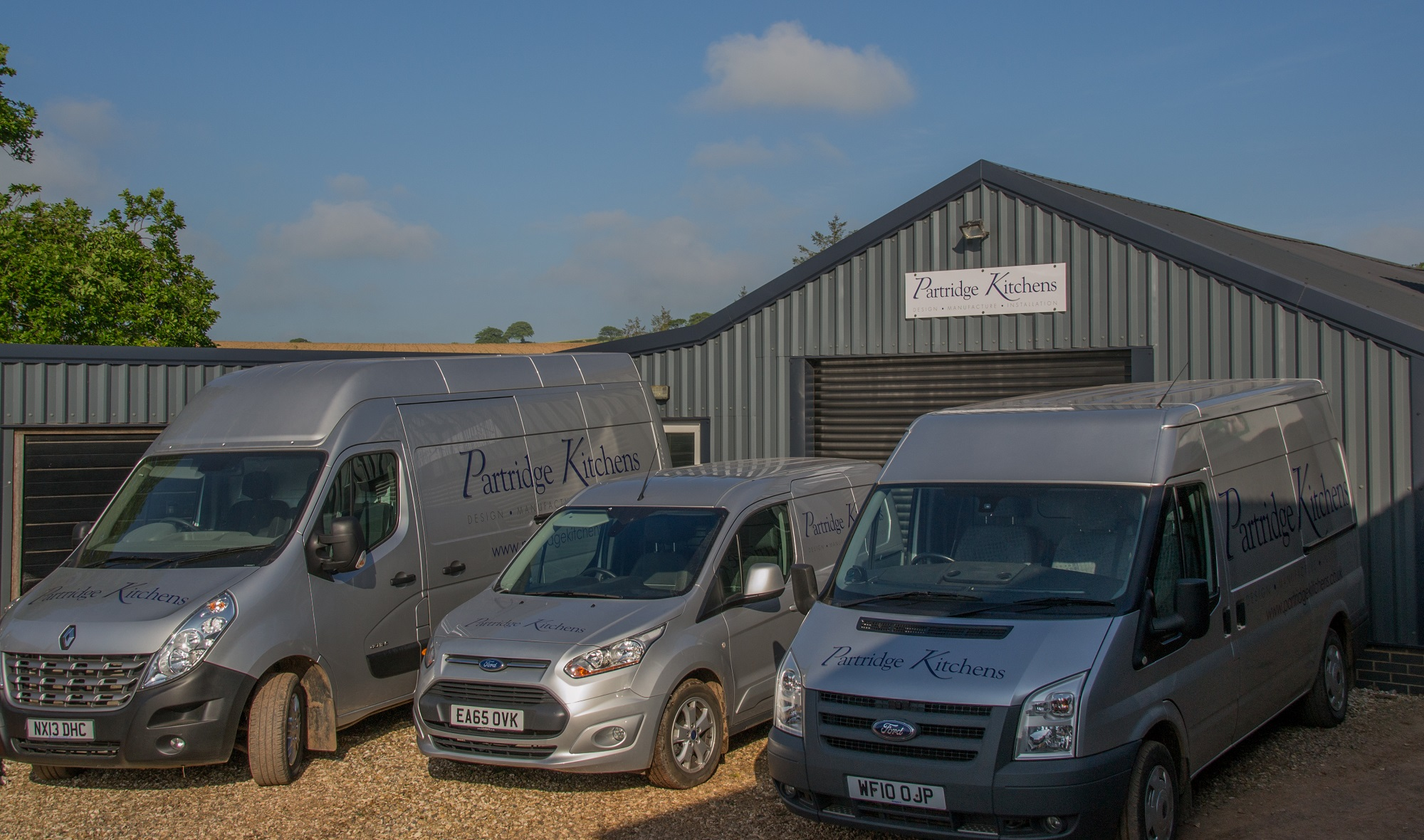 Our three vans outside the Partridge Kitchens workshop